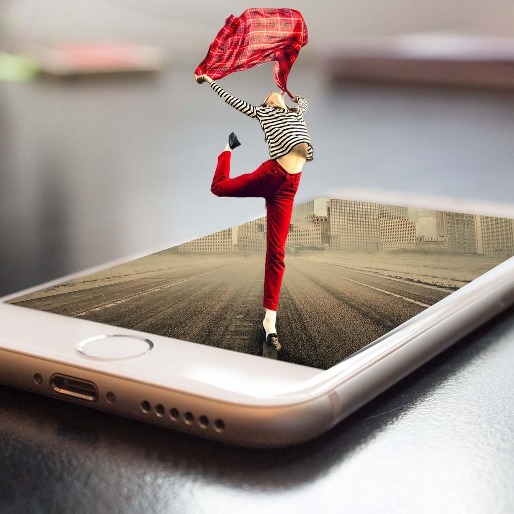 Image numérique sortant d'un smartphone